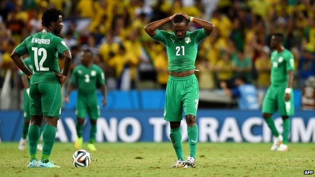 A dejected Wilfried Bony (L) and Giovanni Sio of Ivory Coast react during the 2014 World Cup match between Greece and the Ivory Coast at Castelao on 24 June 2014 in Fortaleza, Brazil
