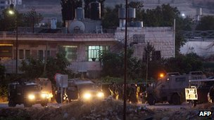 Israeli soldiers outside the town of Halhul near Hebron. 30 June 2014