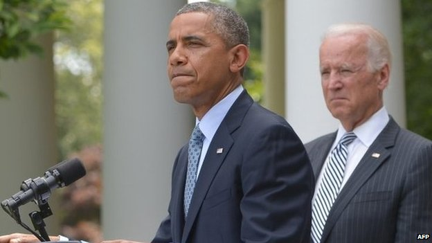 US President Barack Obama speaks in the Rose Garden on immigration reform as US Vice President Joe Biden listens 30 June 2014