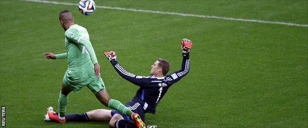 Germany's goalkeeper Manuel Neuer challenges Algeria's Islam Slimani