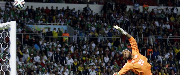 Algeria's goalkeeper Rais Mbolhi dives for the ball