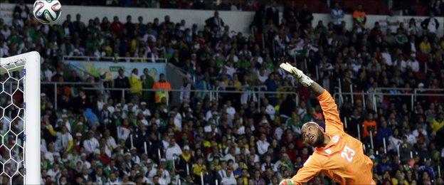 Algeria's goalkeeper Rais Mbolhi dives for the ball