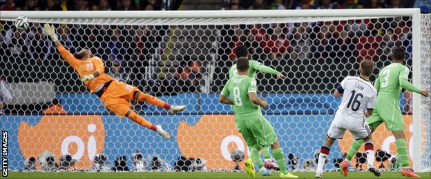 Philipp Lahm forces a fine save from Rais Mbolhi