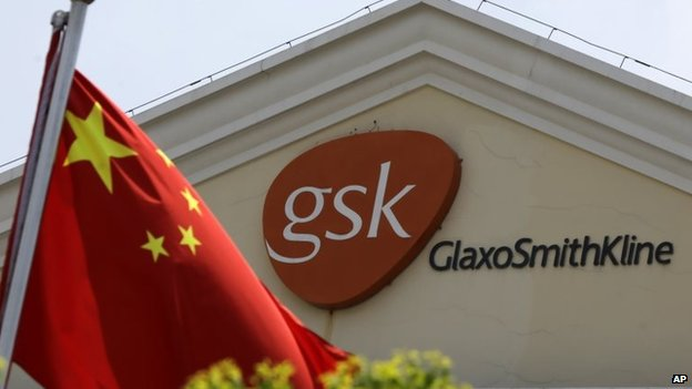 File photo: A Chinese flag is hoisted in front of a GlaxoSmithKline building in Shanghai, China, 24 July 2013