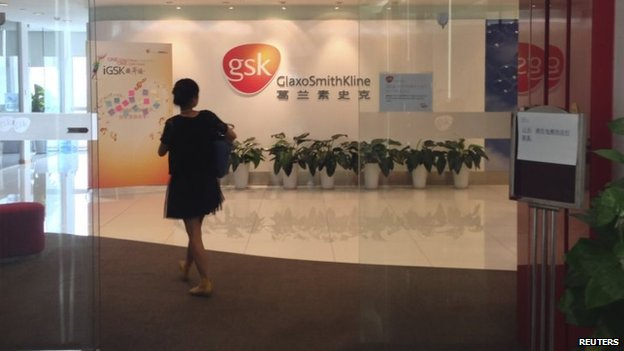 File photo: A Chinese employee walks into a GlaxoSmithKline (GSK) office in Beijing, 19 July 2013