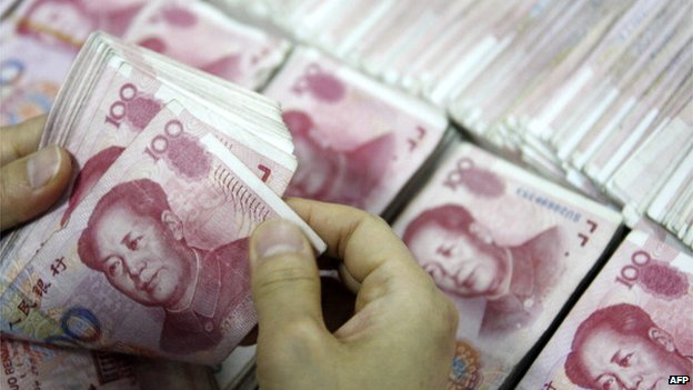 File photo: Chinese 100 yuan (RMB) bank notes being counted at a bank, 24 September 2013
