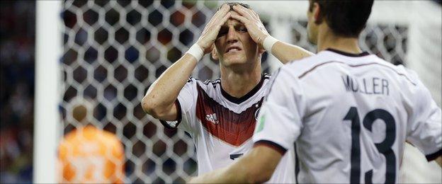 Bastian Schweinsteiger sees his header saved