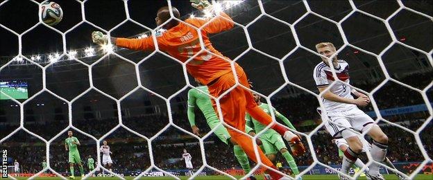 Germany's Andre Schurrle scores past Algeria's goalkeeper
