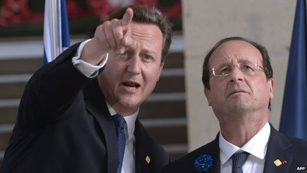 File photo: British Prime Minister David Cameron (left) and French President Francois Hollande gesture during a ceremony to mark the 100th anniversary of the outbreak of World War I in Ypres, 26 June 2014