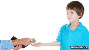 Boy receiving pocket money
