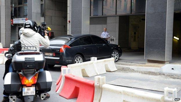Mr Sarkozy's car arrives at the anti-corruption office in Nanterre