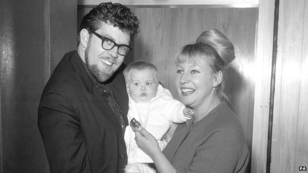 Harris with his wife and daughter