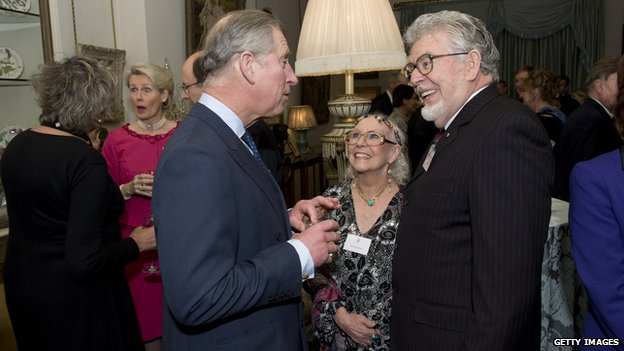 Prince Charles with Harris and his wife