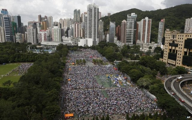 Tens of thousands of residents joined the annual pro-democracy protest in Hong Kong Tuesday, July 1, 2014.