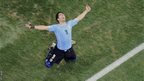 Uruguay's Luis Suarez celebrates scoring his side's second goal during the Group D World Cup match between Uruguay and England at the Itaquerao Stadium in Sao Paulo, Brazil.