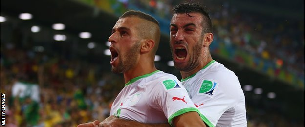 Islam Slimani of Algeria celebrates with Essaid Belkalem