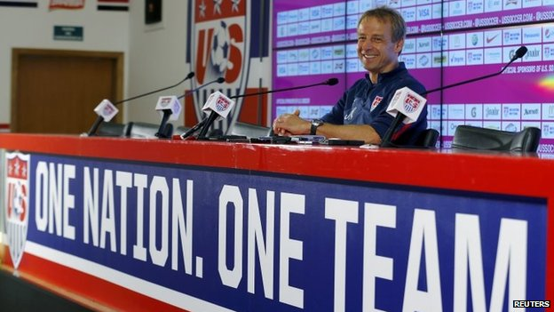 Juergen Klinsmann listens to a question during a news conference at the team's training centre in Sao Paulo on 27 June, 2014