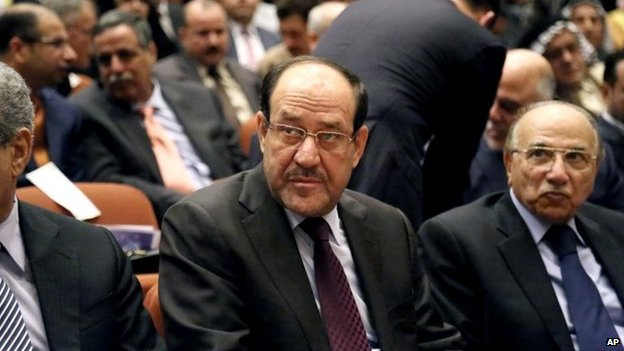 Nouri Maliki (centre) and other members of Iraq's new Council of Representatives attend its first session in Baghdad on 1 July 2014