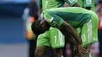 "Nigeria""s players react in dejecting at the end of the World Cup round of 16 soccer match between France and Nigeria at the Estadio Nacional in Brasilia, Brazil, Monday, June 30, 2014"