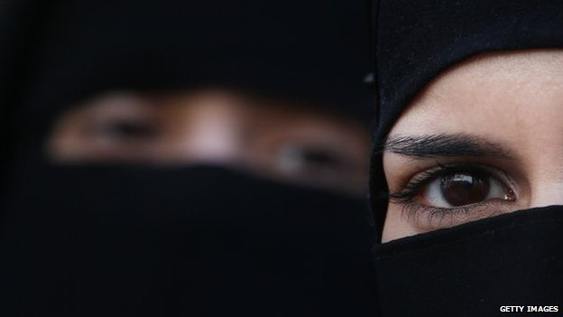 Two women wearing Islamic niqab veils stand outside the French Embassy during a demonstration on 11 April 2011 in London, England.