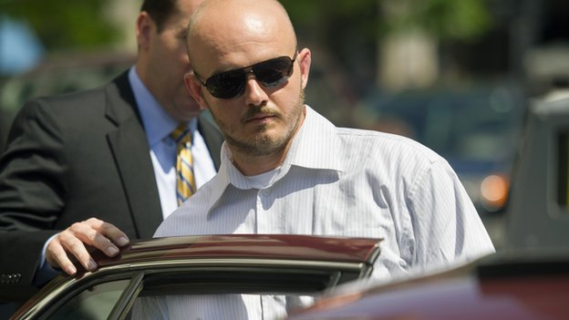 Former Blackwater Worldwide employee  Nicholas Slatten gets out of a car outside a Washington, DC courthouse