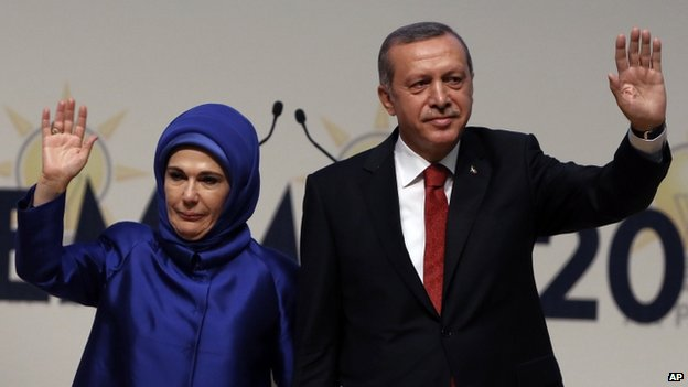 Turkey's PM Recep Tayyip Erdogan and his wife Emine Erdogan salute his ruling party members in Ankara, Turkey, 1 July 2014.
