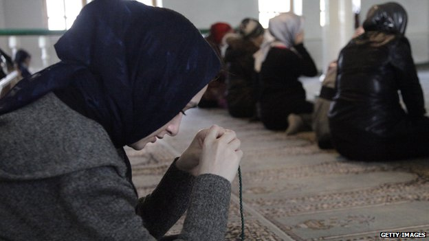 Muslim women pray inside a Moscow mosque on 30 March 2010.