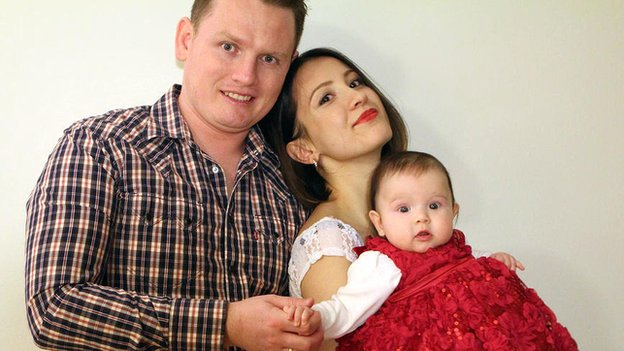 A picture of Alexander Sodiqov with his wife Musharraf and their young daughter was released by the family