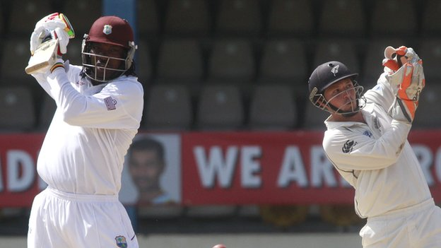 West Indies' Chris Gayle and New Zealand's BJ Watling
