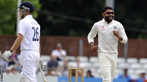 India's Ravindra Jadeja celebrates the wicket of Derbyshire's Ben Slater (left)