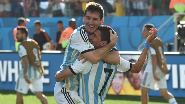Lionel Messi and Angel Di Maria celebrate after Argentina beat Switzerland
