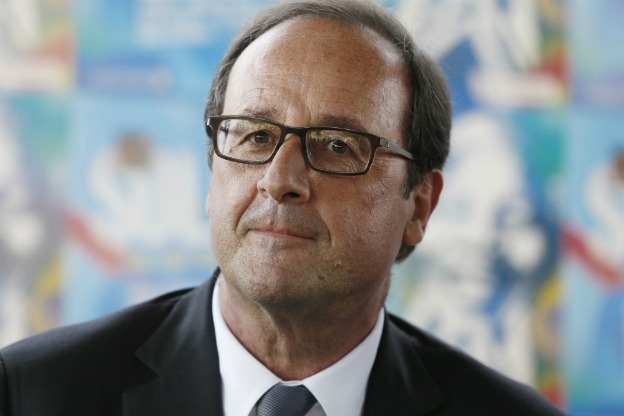 French President Francois Hollande looks on during a meeting with Solidays festival volunteer in Paris - 29 June 2014