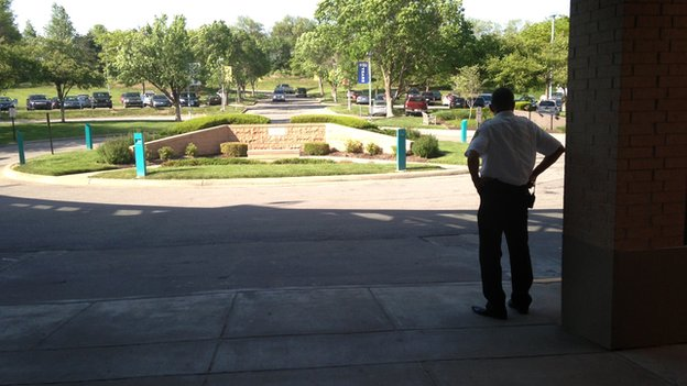 A security guard looking at the car park of the Jewish Community Center