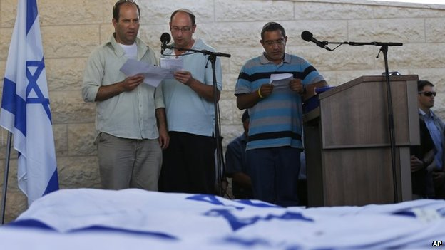 From left, Avi Fraenkel, Ofir Shaer and Ori Yifrah, fathers the three Israeli teens who were abducted and killed in the occupied West Bank, read their eulogies at the funeral in Modein, 1 July 2014