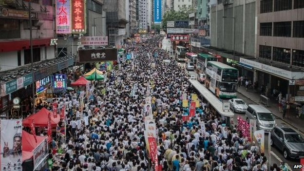 Demonstrators march during a pro-democracy rally seeking greater democracy in Hong Kong, 1 July 2014
