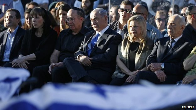 Israeli Prime Minister Benjamin Netanyahu (3rd R, front) and his wife Sara (2nd R, front), Defence Minister Moshe Yaalon (3rd L, front) and President Shimon Peres (R, front) attend the joint funeral of the three Israeli teens who were abducted and killed in the occupied West Bank, in the Israeli city of Modein, 1 July 2014