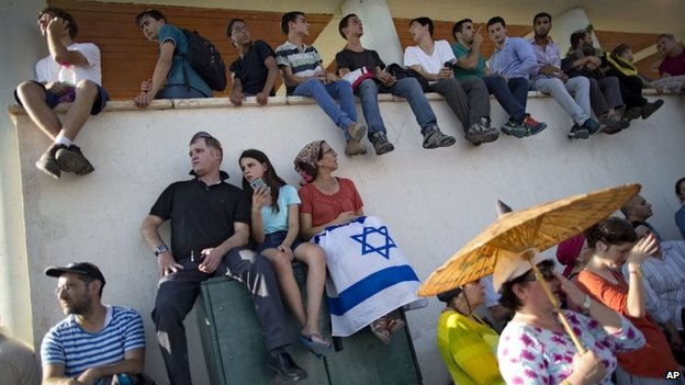Israelis attend the funeral of three Israeli teenagers in the Israeli town of Modien on 1 July 2014