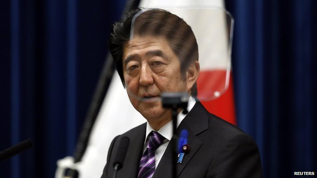 Japan's Prime Minister Shinzo Abe attends a news conference at his official residence in Tokyo on 1 July, 2014