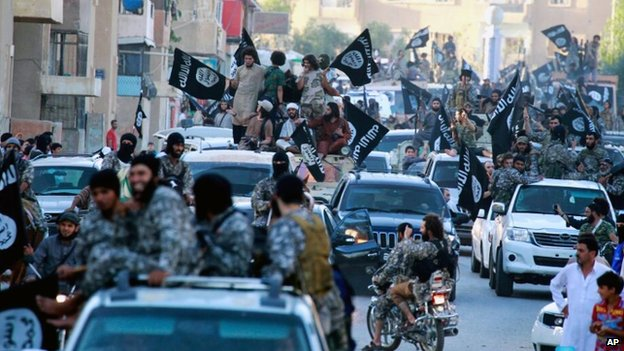 Isis fighters during a parade in Raqqa, Syria (1 July 2014)