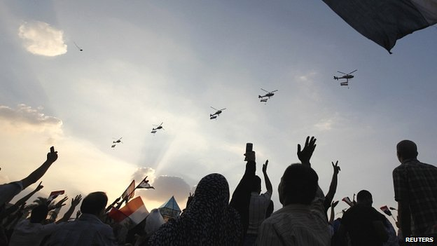 Egyptian military helicopters fly above Tahrir Square on July 1 2013