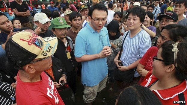 Basuki Tjahaja Purnama talks to residents affected by floods during his visit to Jakarta on 19 January 2013