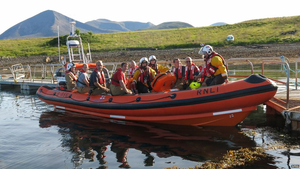 firefighters in lifeboat