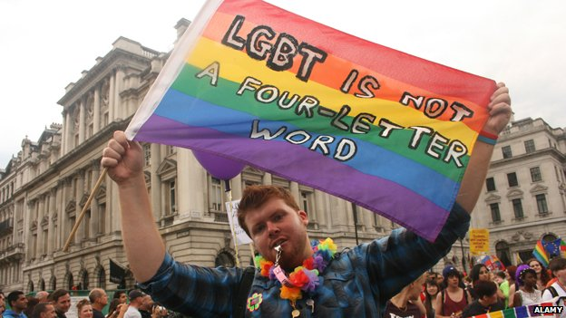 "Man holding banner which reads: ""LGBT is not a four-letter word"""