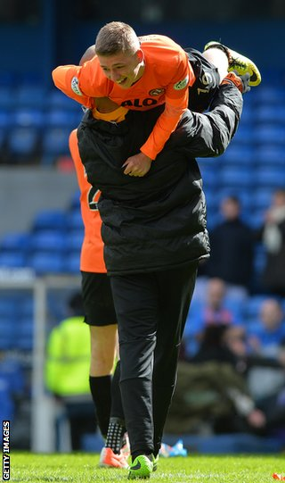 Gauld is carried off the pitch following United's Scottish Cup semi-final win over Rangers
