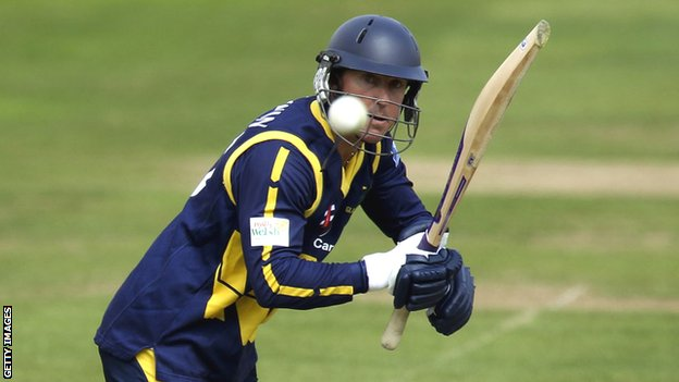 Glamorgan batsman Murray Goodwin watches the ball after playing a shot