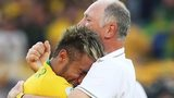Brazil manager Luiz Felipe Scoalri (right) hugs Neymar after the win over Chile on penalties