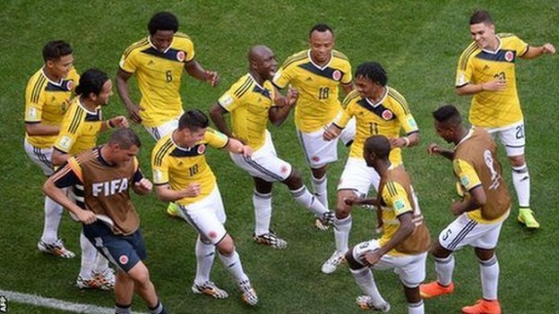 Colombia players celebrate a goal at the 2014 World Cup