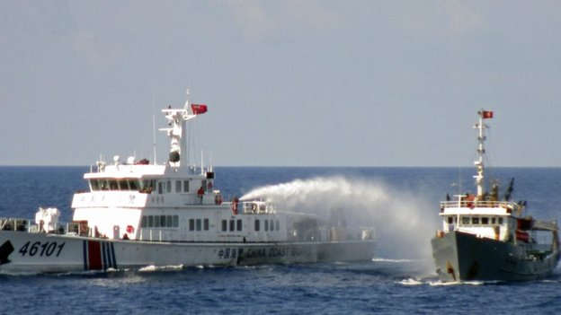 A Chinese coastguard vessel uses water cannon on a Vietnamese Sea Guard ship on the South China Sea near the Paracels islands, in this handout photo taken on 4 May, 2014 and released by Vietnam Marine Guard on 8 May, 2014