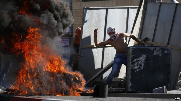 Palestinian demonstrators in East Jerusalem, 2 July 2014