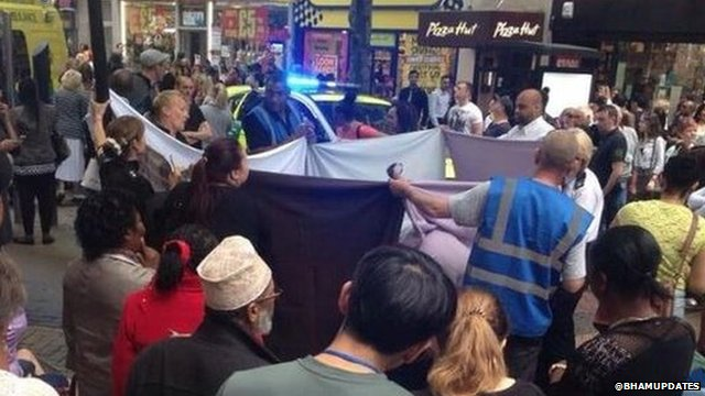 Security staff held up a sheet around the woman to give her privacy as she gave birth